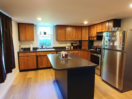 customer kitchen after renovation. granite countertops, new recessed lighting, new cabinets